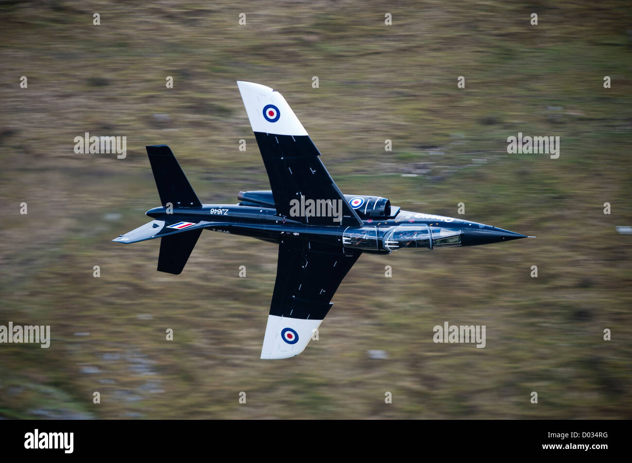 Alpha Jet operated by by QinetiQ Boscombe Down low level flying in the mach loop north Wales. - Stock Image
