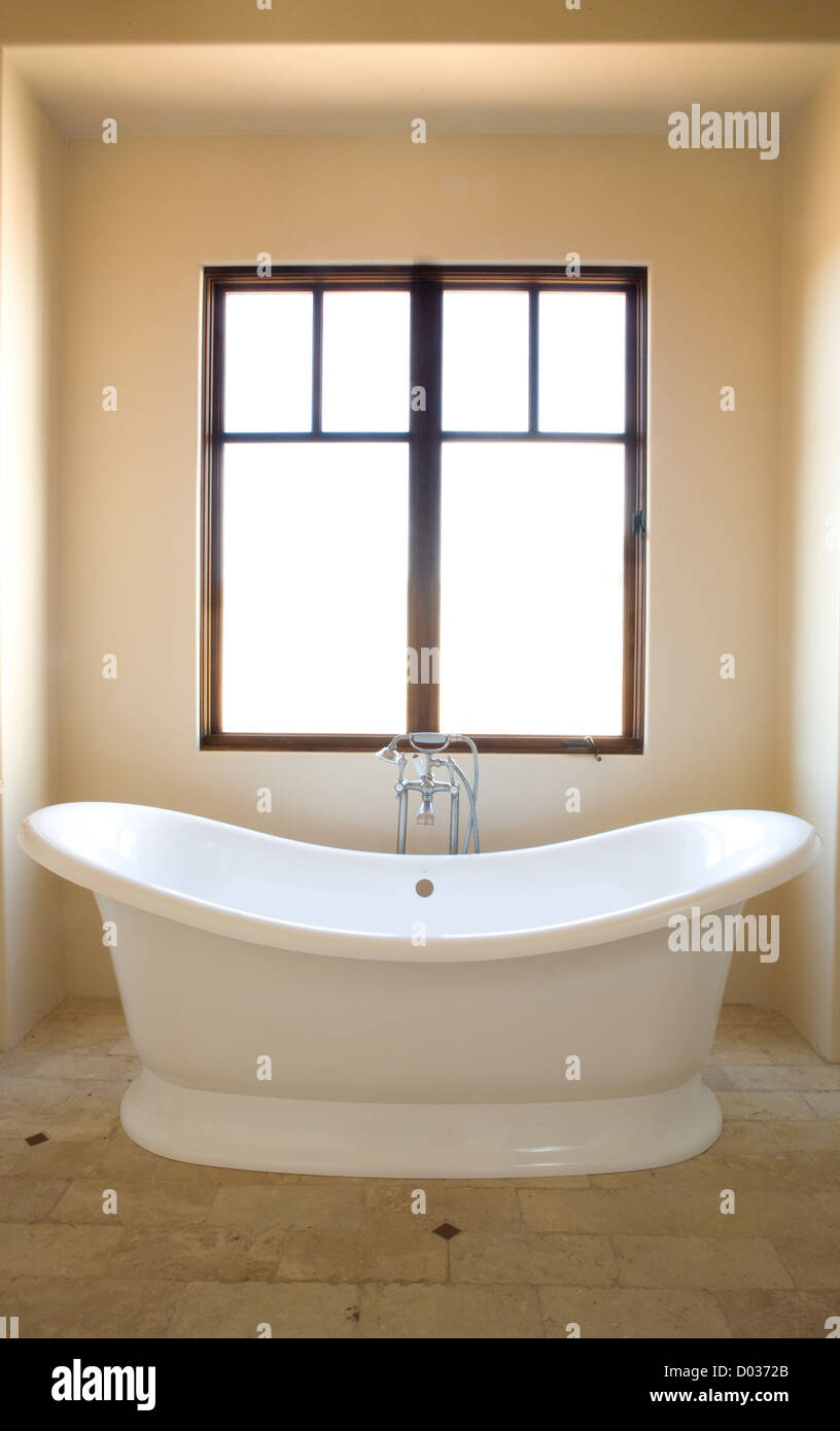 Luxurious modern shaped bath tub in a clean and contemporary Stock ...