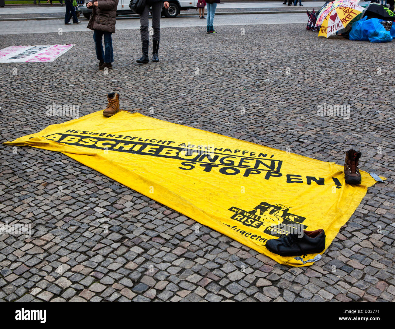 Banner of Asylum seekers protesting against deportation, poor living conditions and slow processing of residency - Stock Image