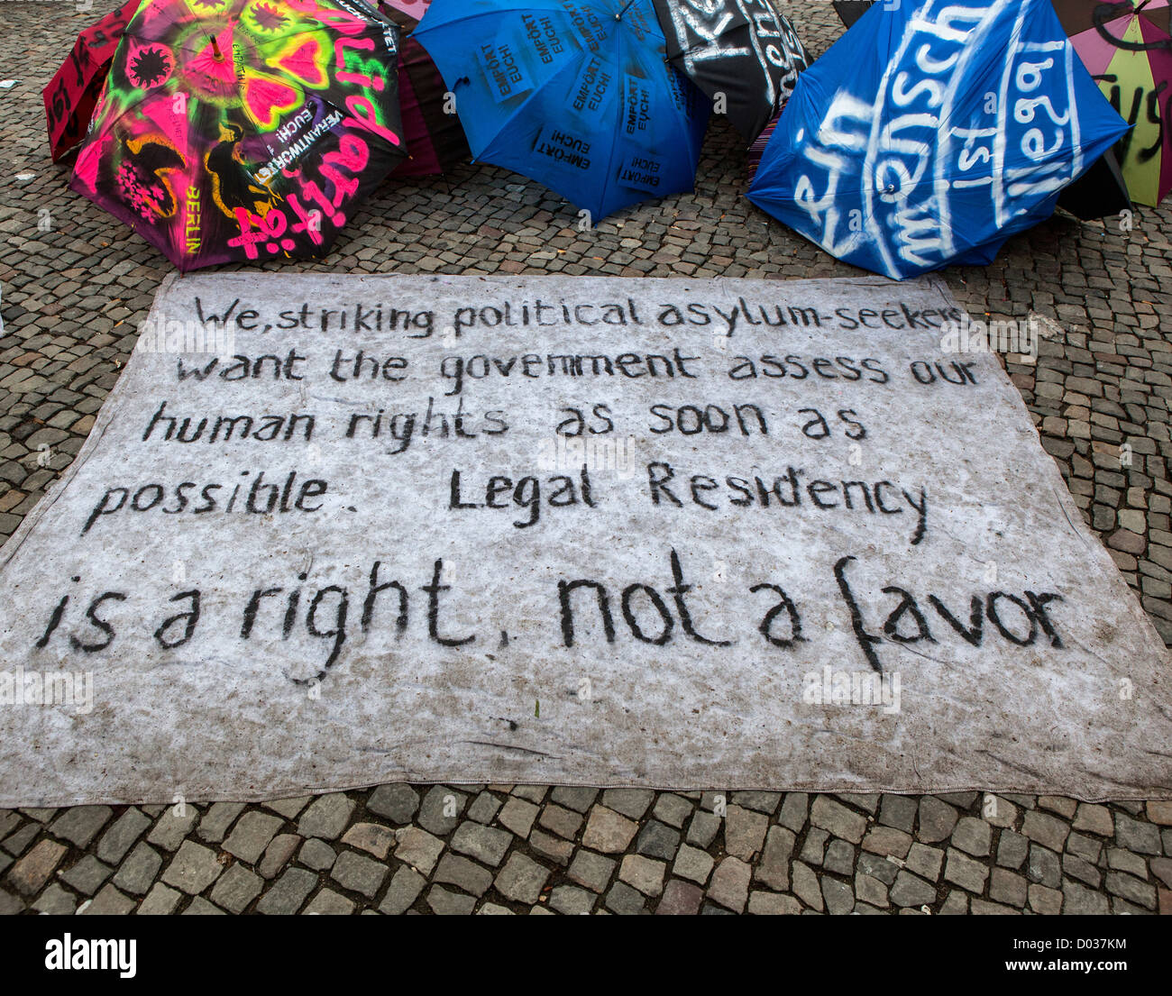 Slogans of Asylum seekers protesting against deportation, poor living conditions and slow processing of residency - Stock Image
