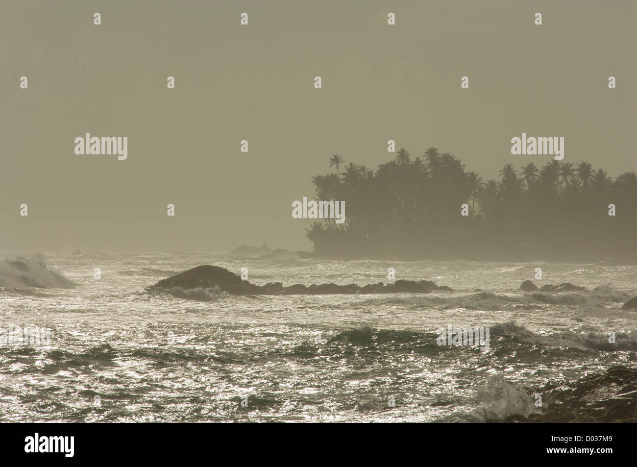 Spray over a stormy sea at sunset, Galle, Sri Lanka Stock Photo