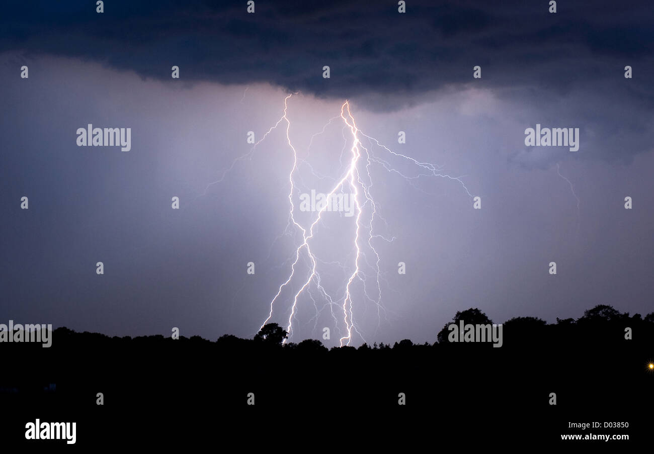 Thunder and lightning at the end of a warm day in the Netherlands - Stock Image