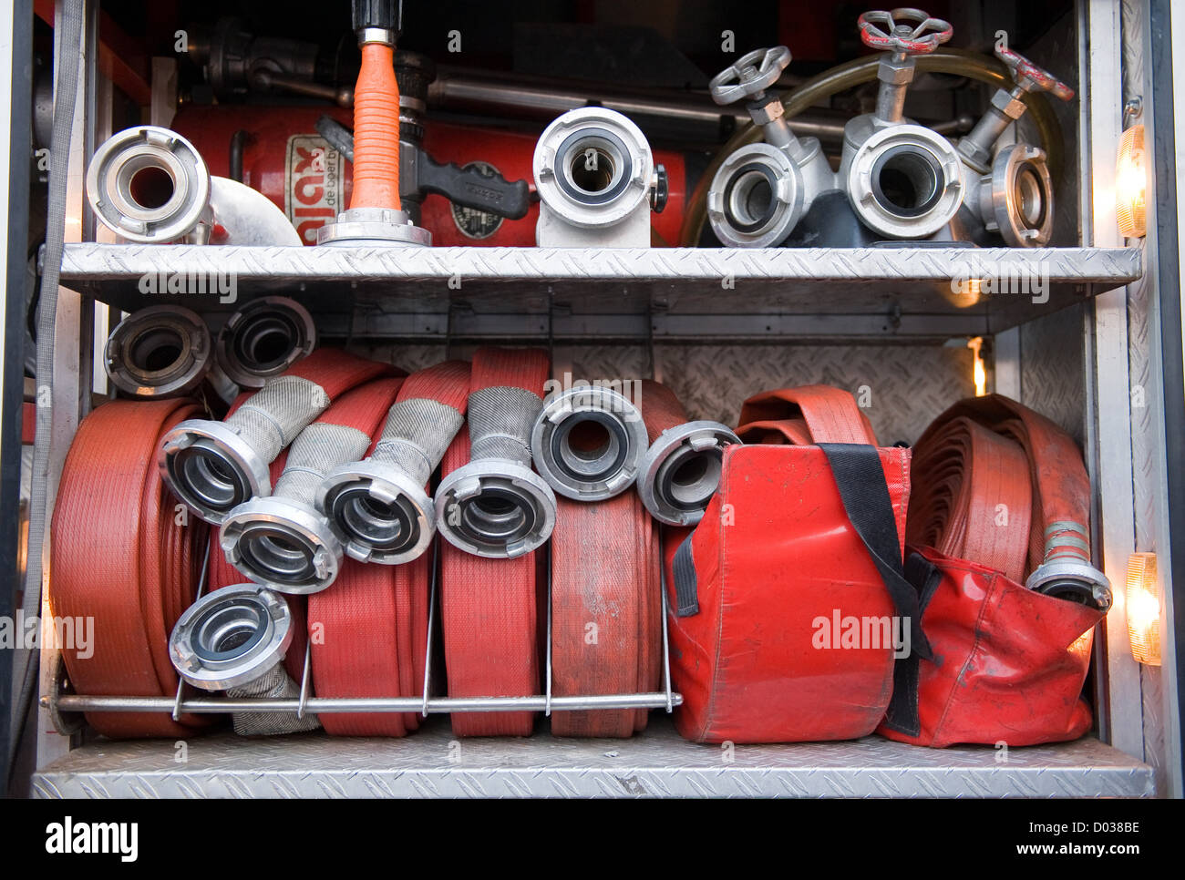 Fire hoses and other equipment in a truck to be used by firefighters - Stock Image