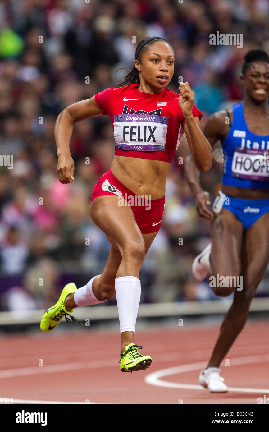 Allyson Felix (USA) competing in round 1 of the Women's 200 meters at the Olympic Summer Games, London 2012 - Stock Image