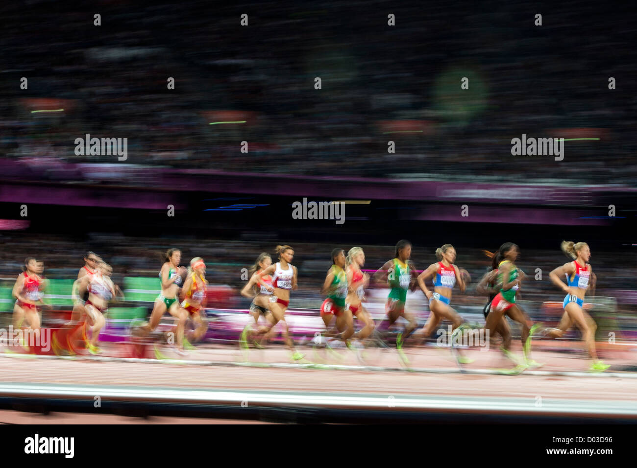 Blurred action of women competing in the Women's 3000m Steeplechase at the Olympic Summer Games, London 2012 Stock Photo