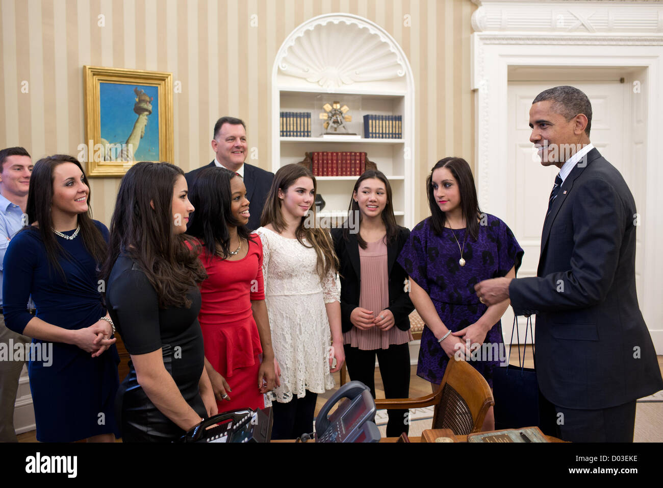 US President Barack Obama talks with members of the 2012 US Olympic gymnastics teams in the Oval Office of the White - Stock Image