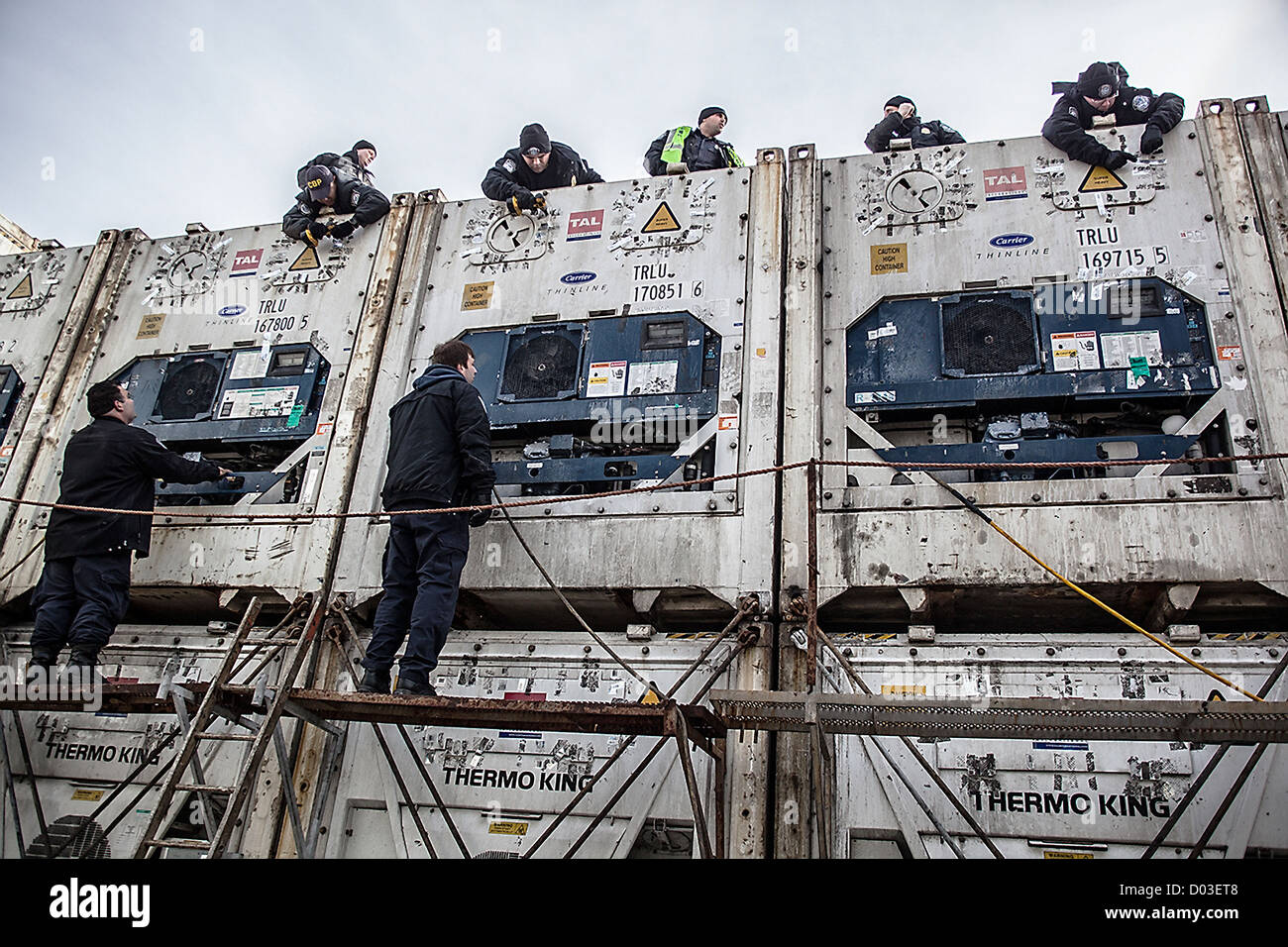 US Customs & Border Protection police inspect cargo containers November 11, 2012 at the Port of New York in - Stock Image