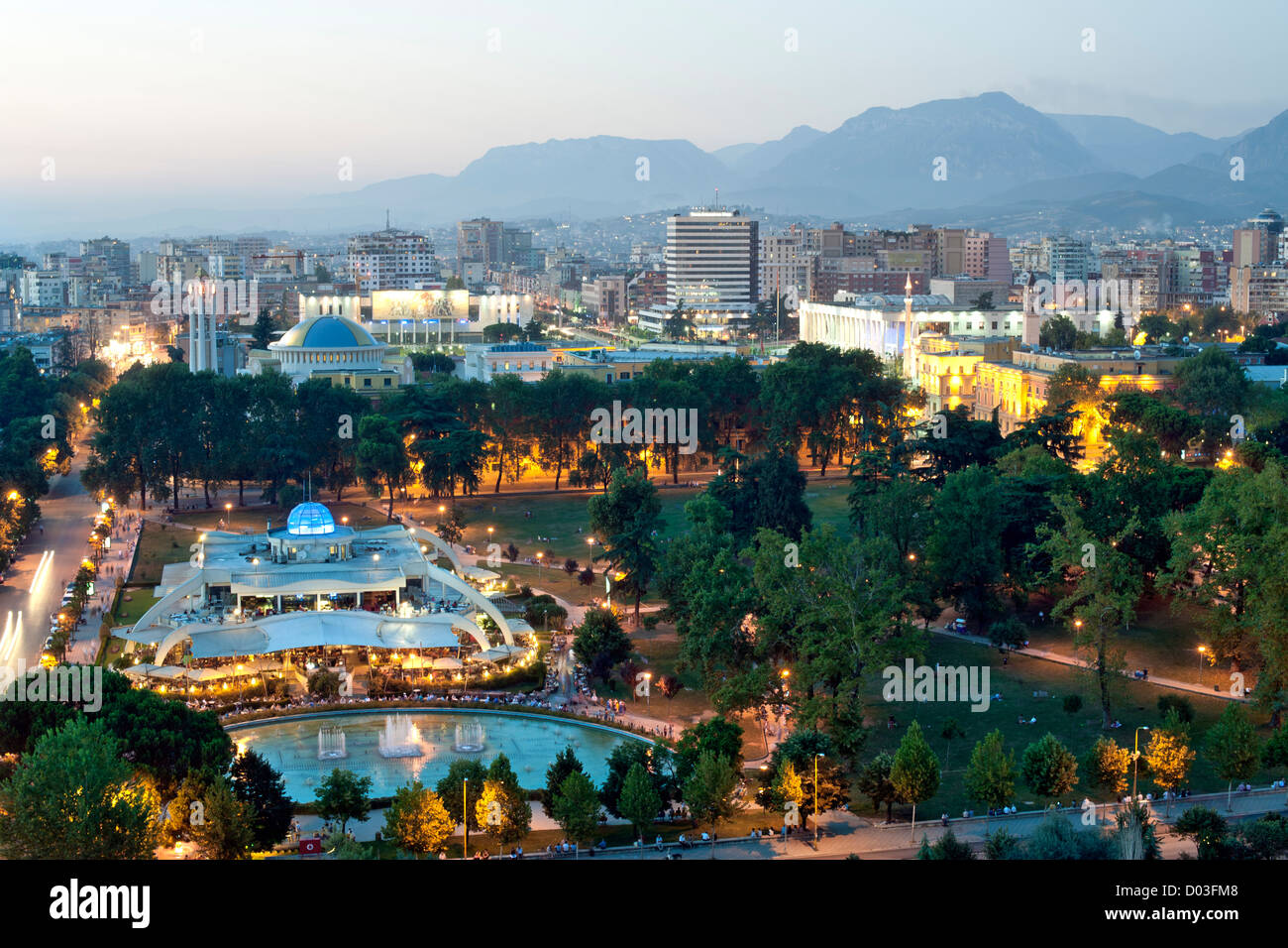 Dusk view of Tirana, the capital of Albania. In the foreground is Rinia Park. Stock Photo