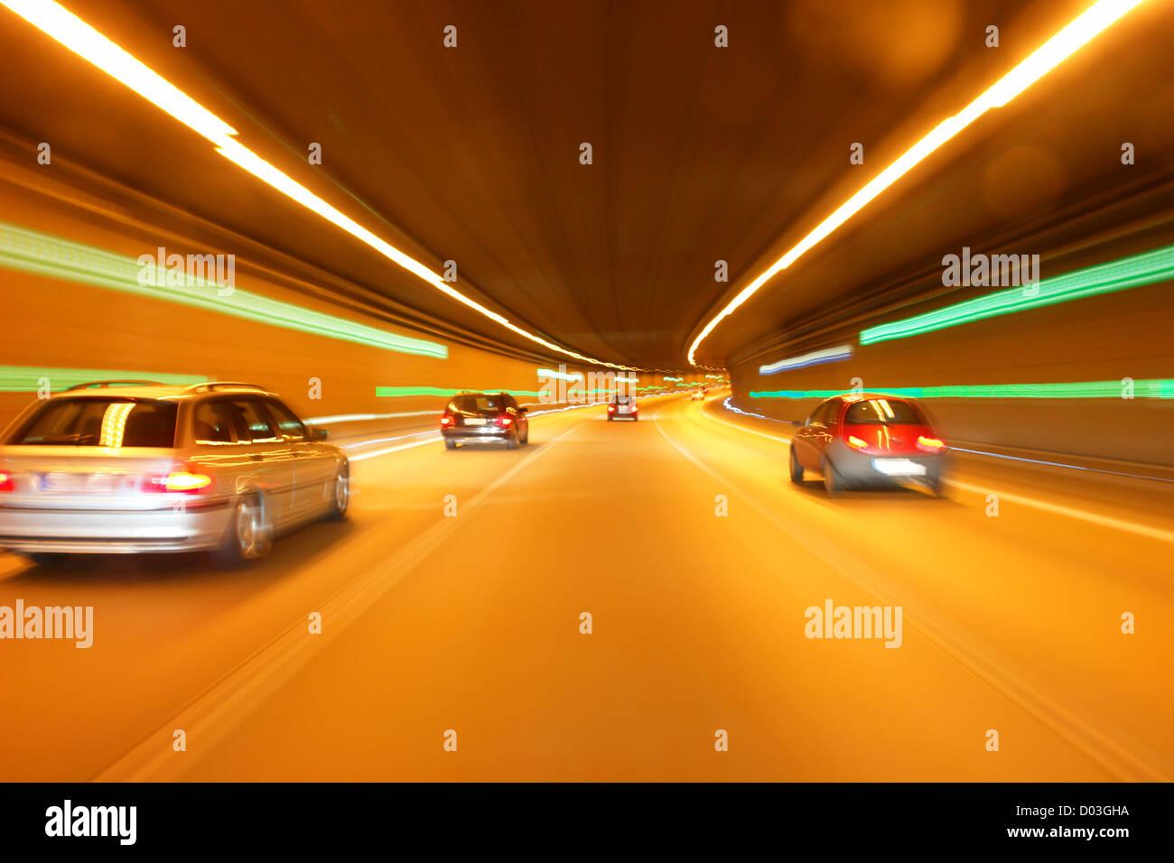 tunnel car motion blur night traffic fast - Stock Image