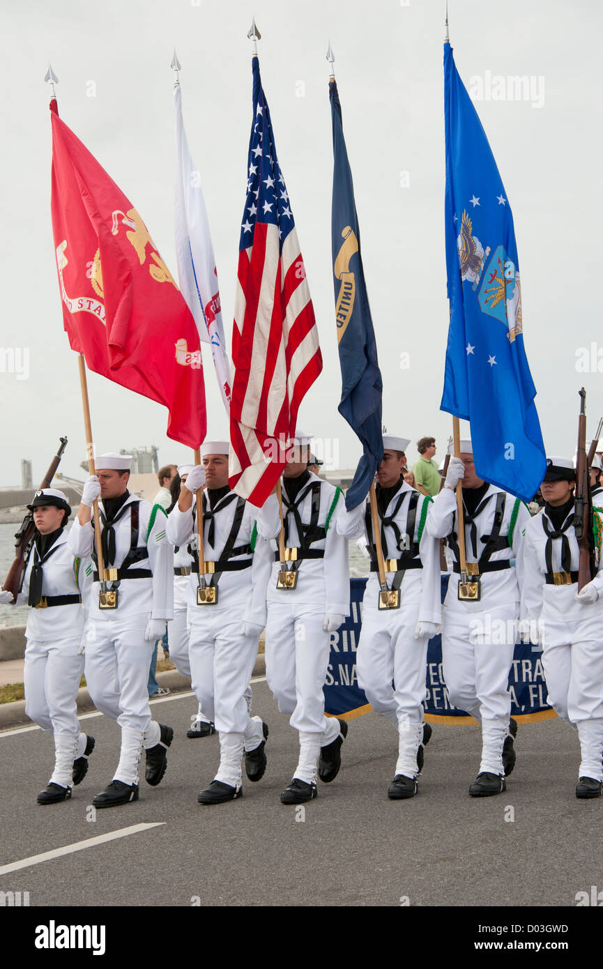 Military color guard carries flags in parade Stock Photo