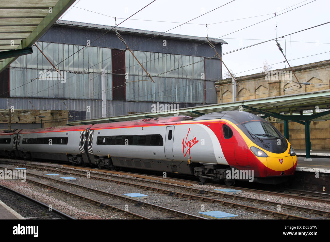 Class 390 Virgin Pendolino electric multiple unit train at Carlisle station on a service to Glasgow Central. Stock Photo