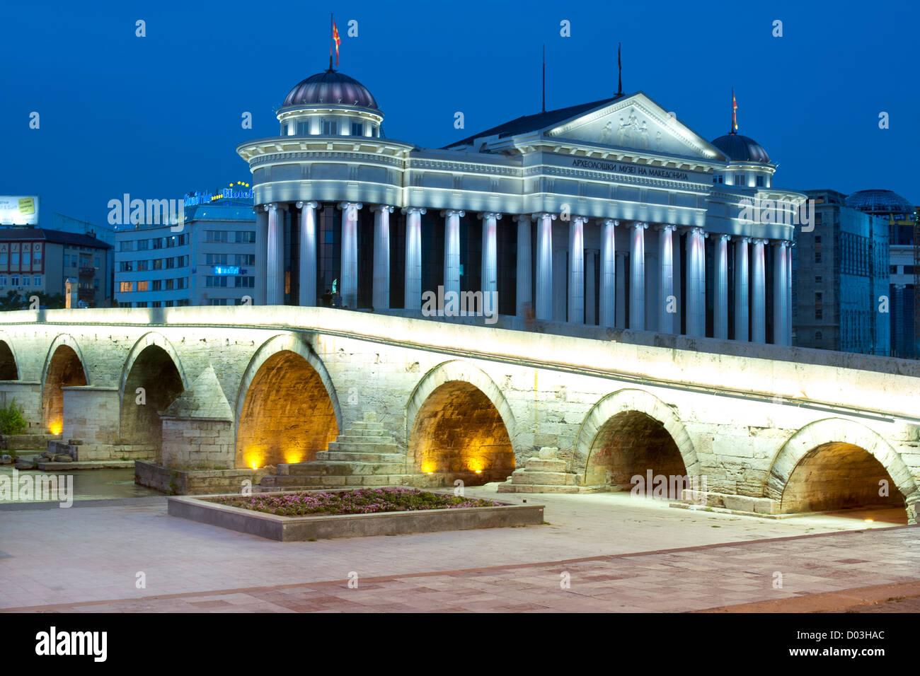 Night view of the Old Stone Bridge (aka Tsar Dušan's Bridge) over the Vardar River in Skopje, the capital of - Stock Image