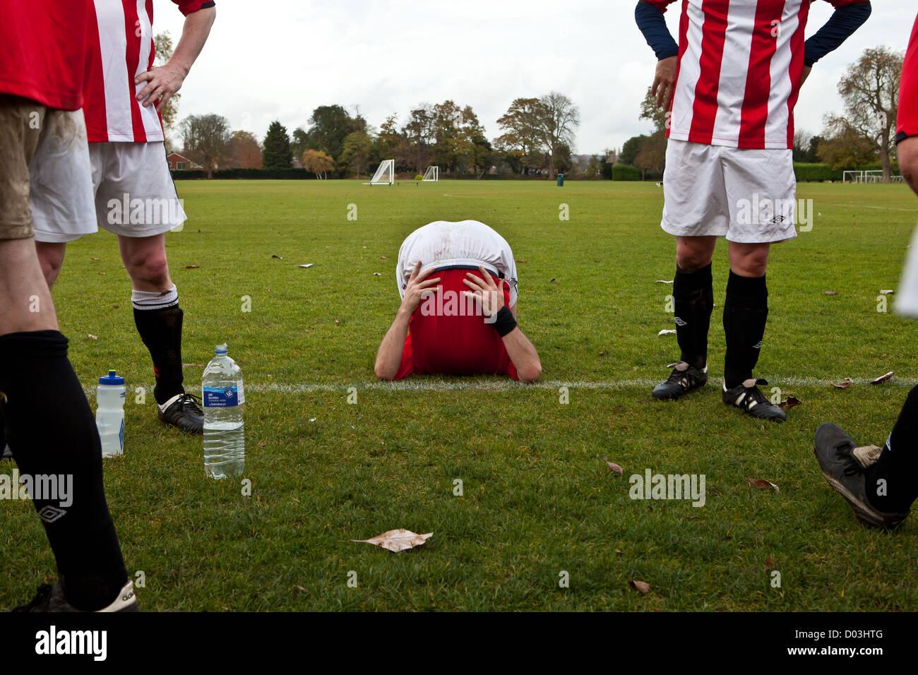 Half -time break for football team - Stock Image