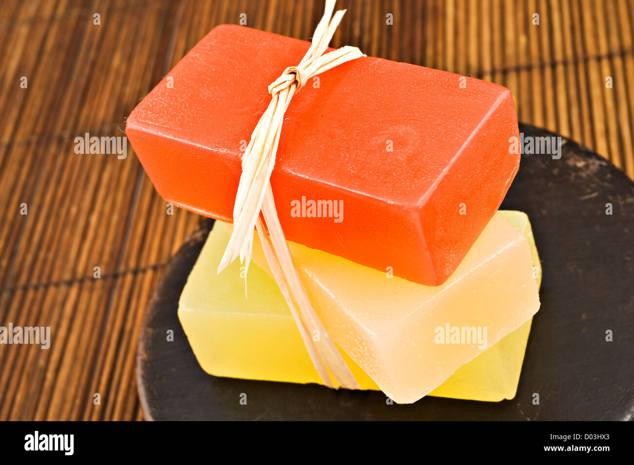 Three bars of organic glycerin soap in a spa. - Stock Image