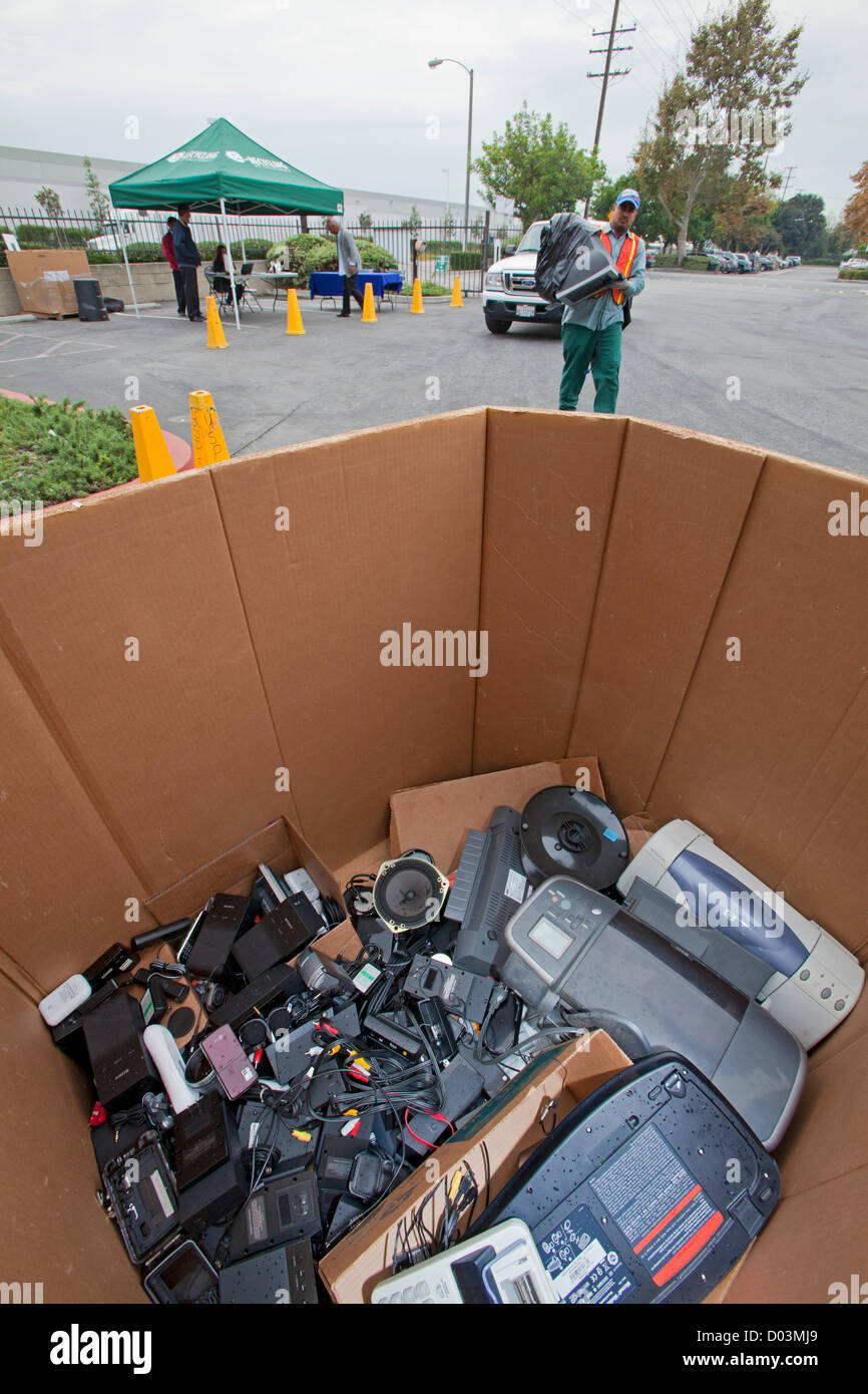 Electronic and computer equipment is sorted and recycled at Sony offices in Carson, California, as part of America - Stock Image