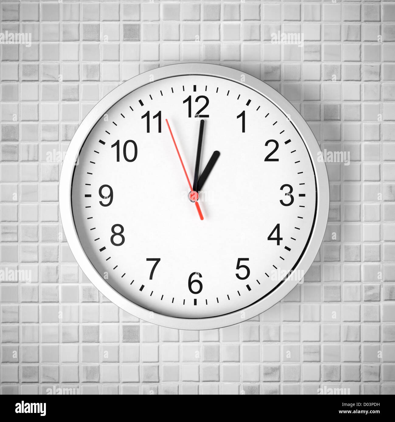 Simple Clock Or Watch On White Tile Wall Displaying One O