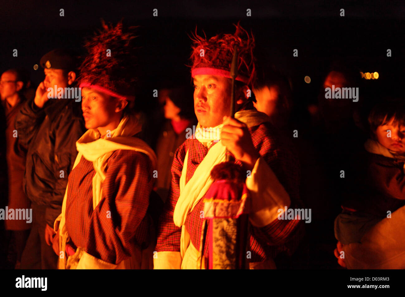Monks worshiping at night in a Bhutan festival. - Stock Image