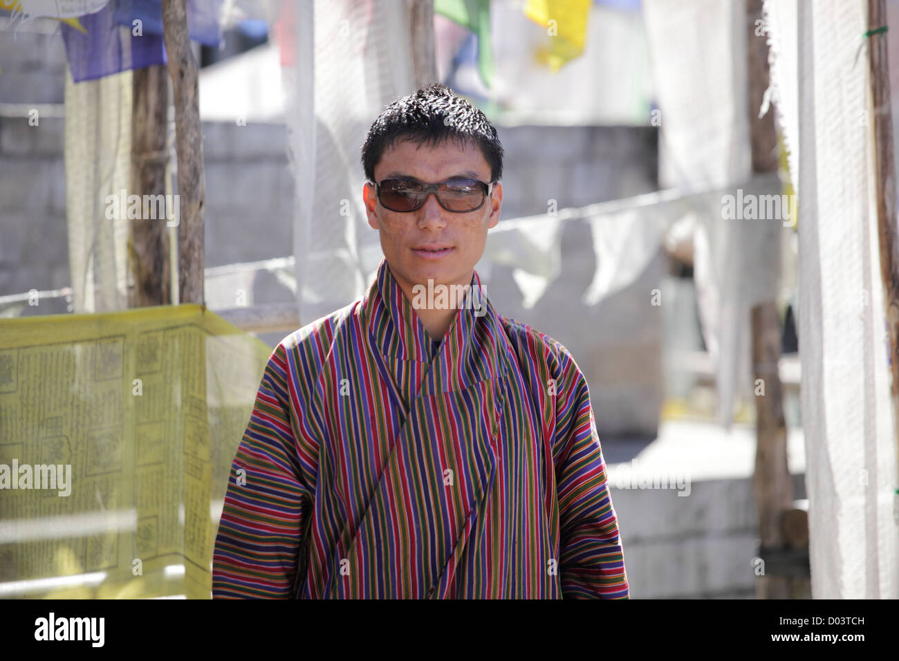 An handsome adult monk with this sunglasses posing for the camera. - Stock Image