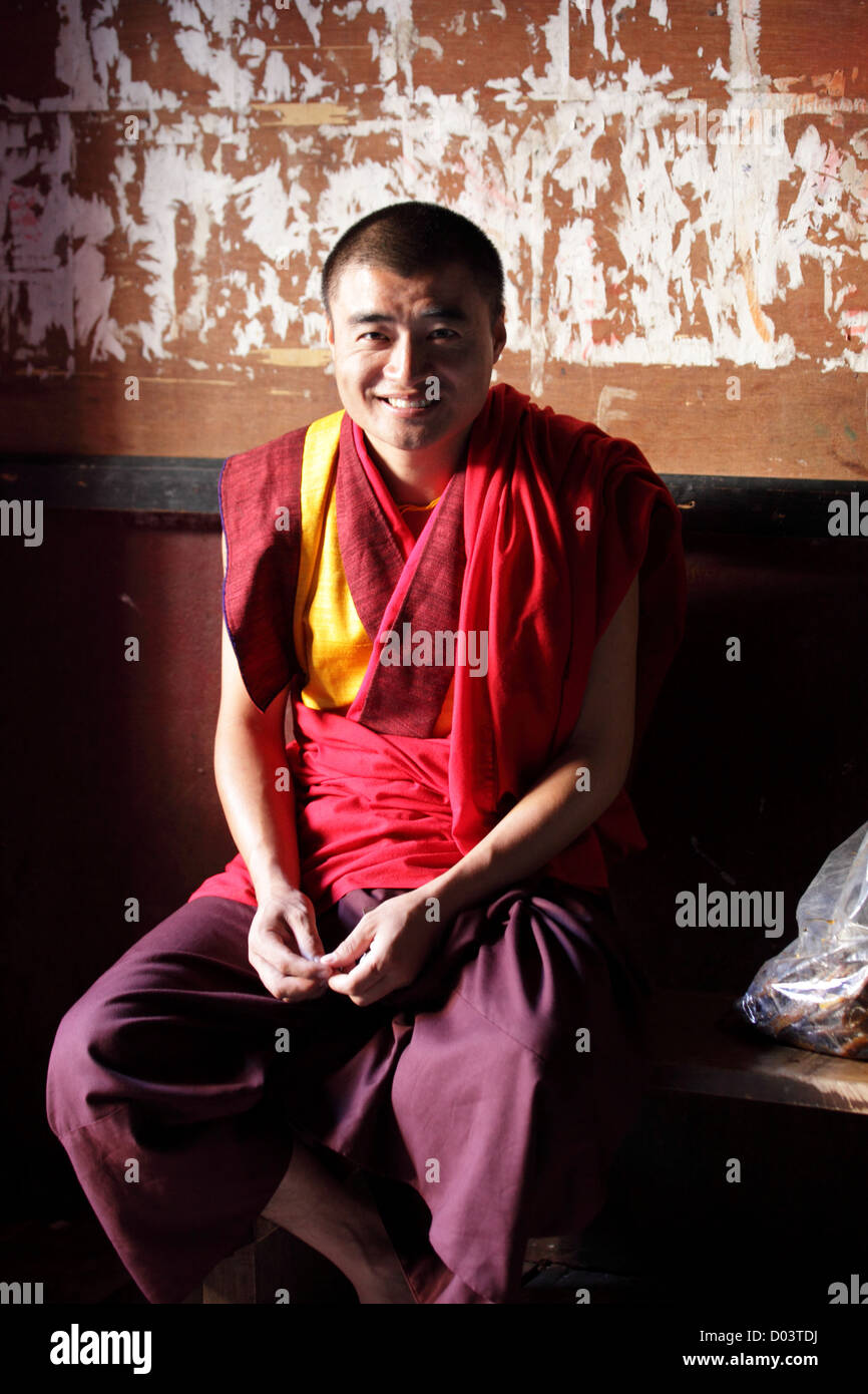 Monk smiles as his picture is been taken. - Stock Image