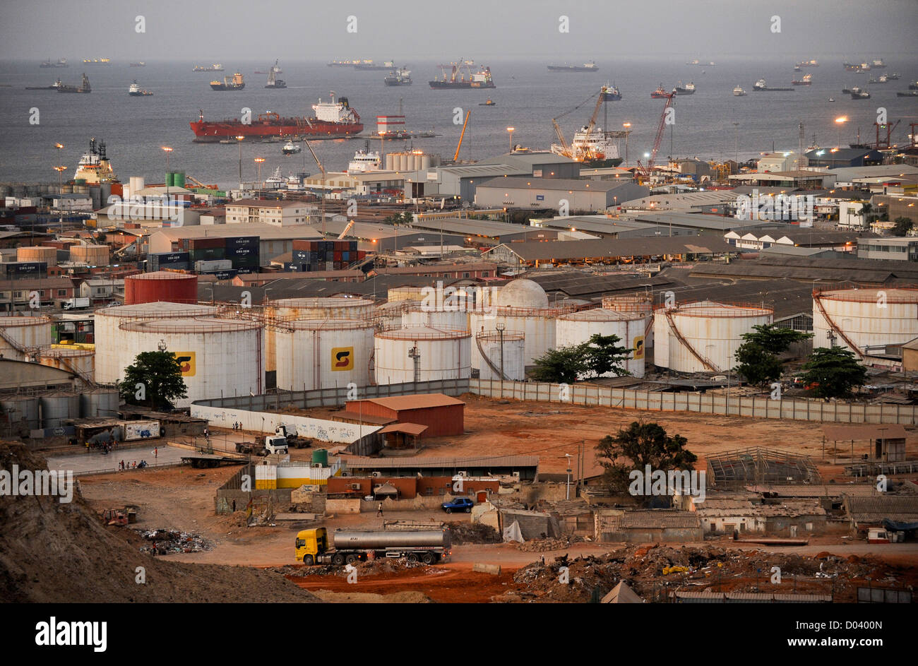 ANGOLA Luanda by night , harbor and anchorage, in front oil tanks of Sonangol the national oil company - Stock Image
