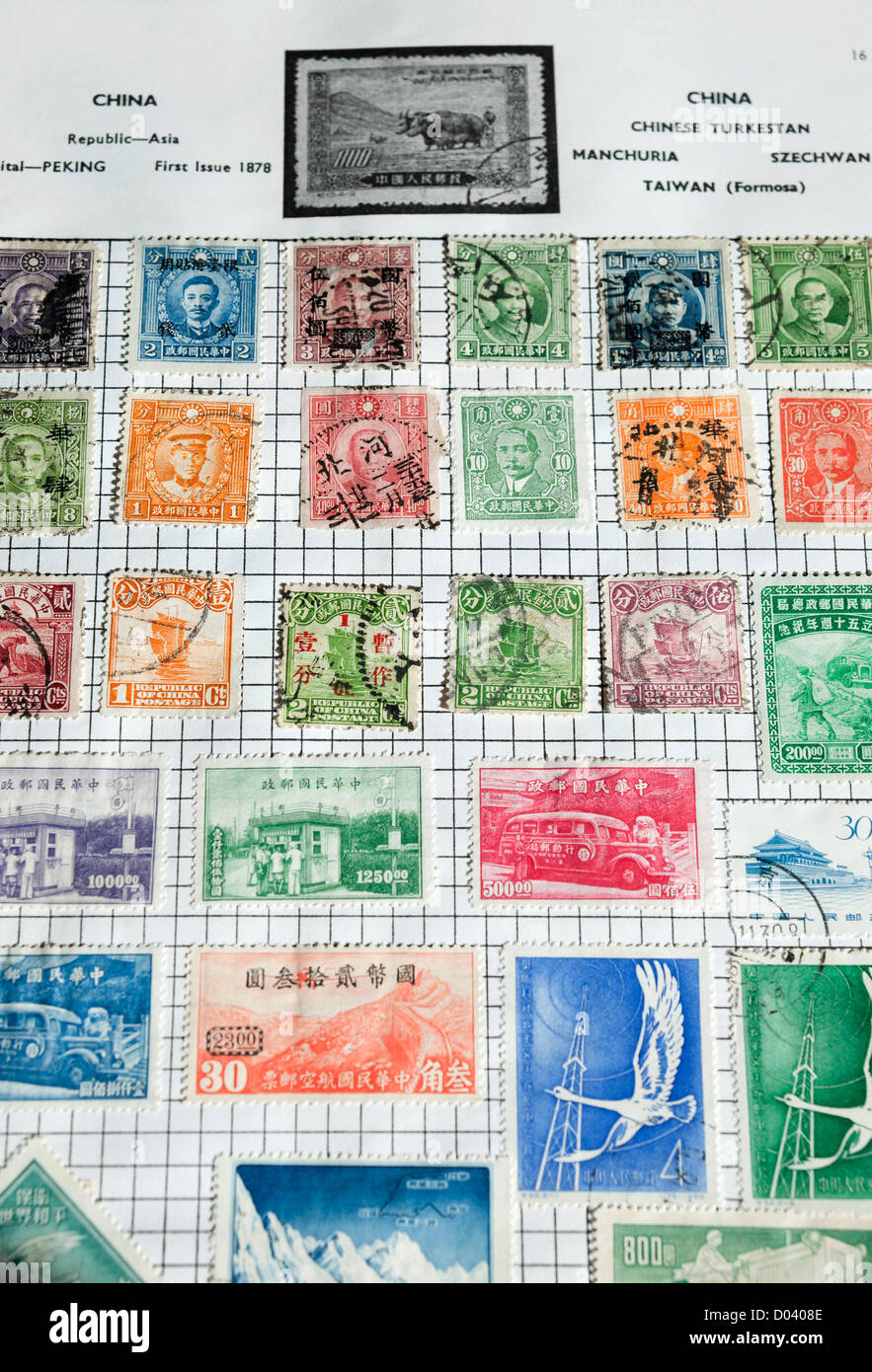 Page of Chinese stamps in album - Stock Image