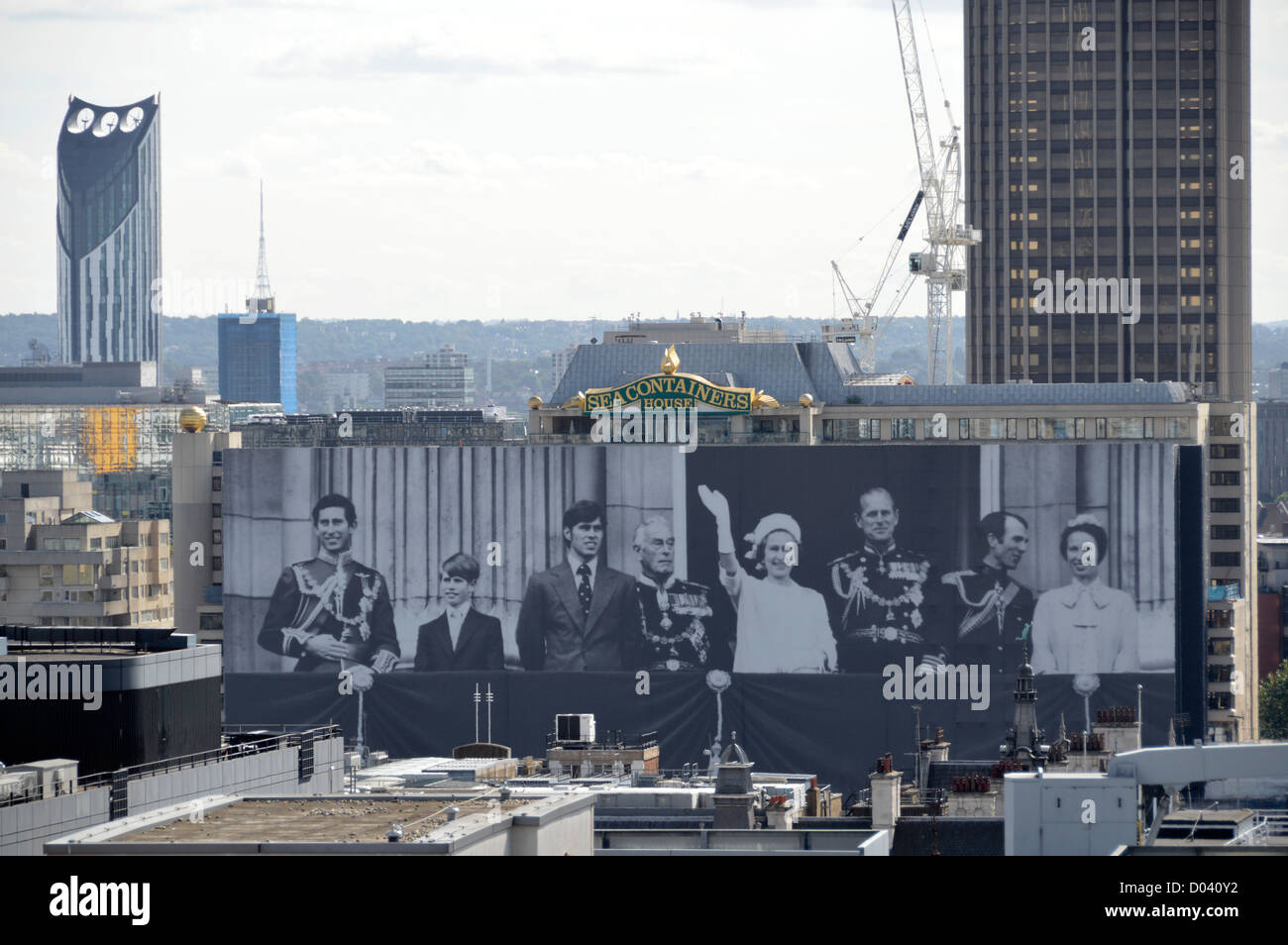 Sea Containers House adorned with black and white photograph of the British Royal Family - Stock Image