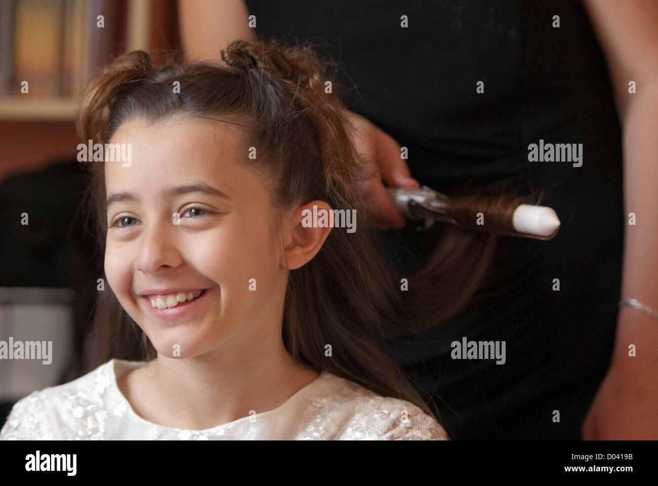 Young girl at the hairdresser, Firenze, Tuscany, Italy - Stock Image