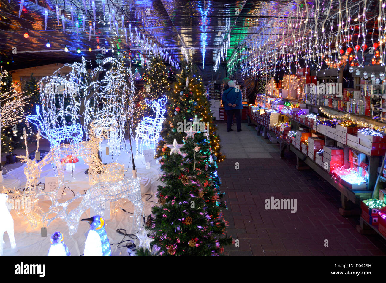 Display of illuminated Christmas decorations on sale in a ...