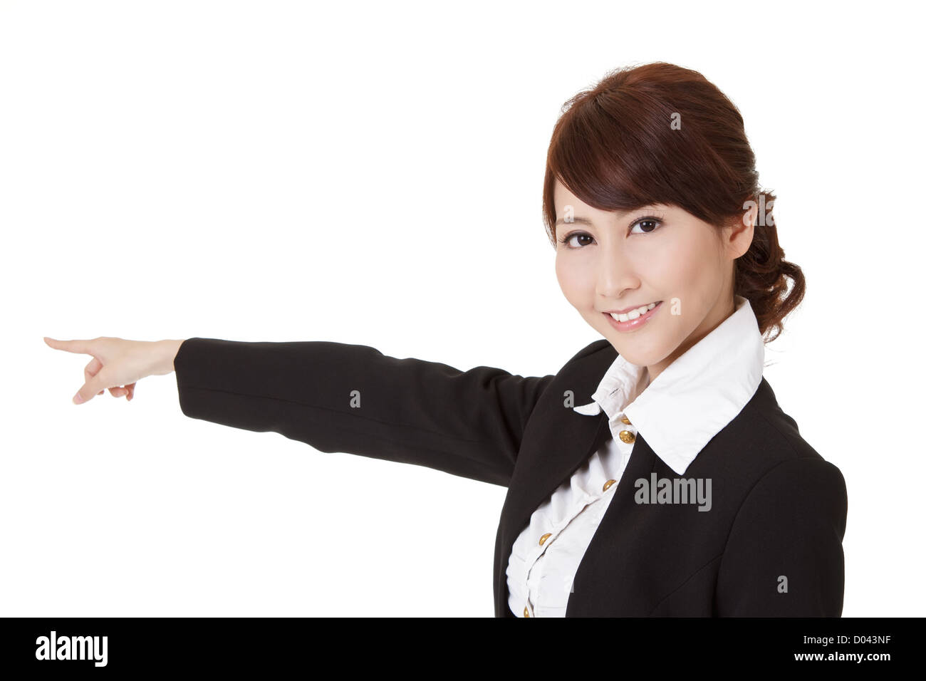 Smiling business woman presenting and looking at you, half length closeup portrait on white background. - Stock Image