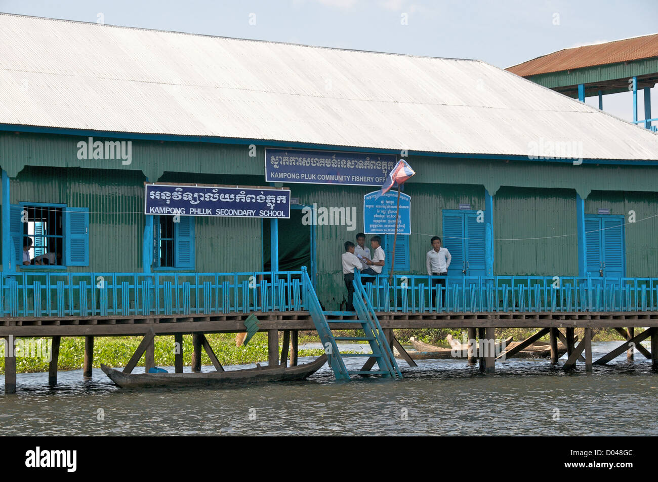 Kampong Phluk secondary school and Kampong Phluk community fishery office Tonle Seap lake Cambodia - Stock Image
