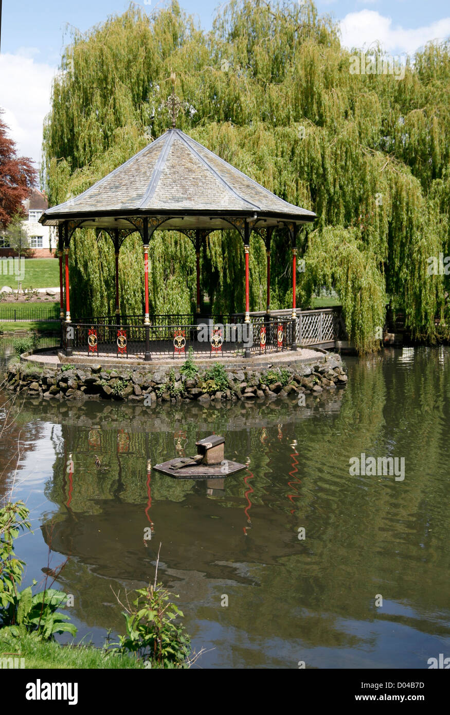 Bandstand on island in pond and weeping willow Gheluvelt Park Worcester Worcestershire England UK - Stock Image