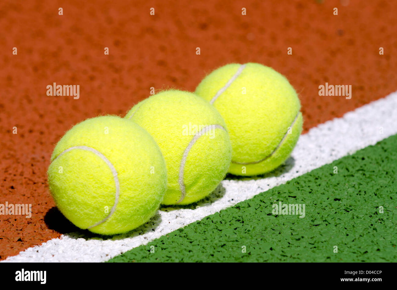 Tennis balls on a tennis court. - Stock Image