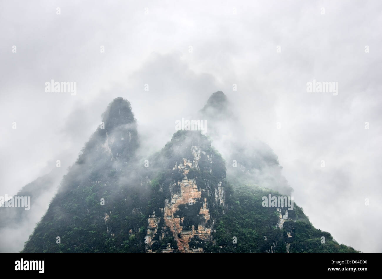 Karst Hills Surrounded By Mist Like in a Chinese Painting Stock Photo