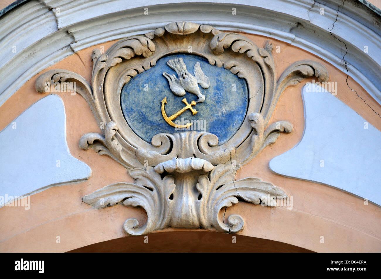 Prague, Czech Republic. Canonical House - Hradcanské Square 7/68. House sign: dove with anchor - Stock Image