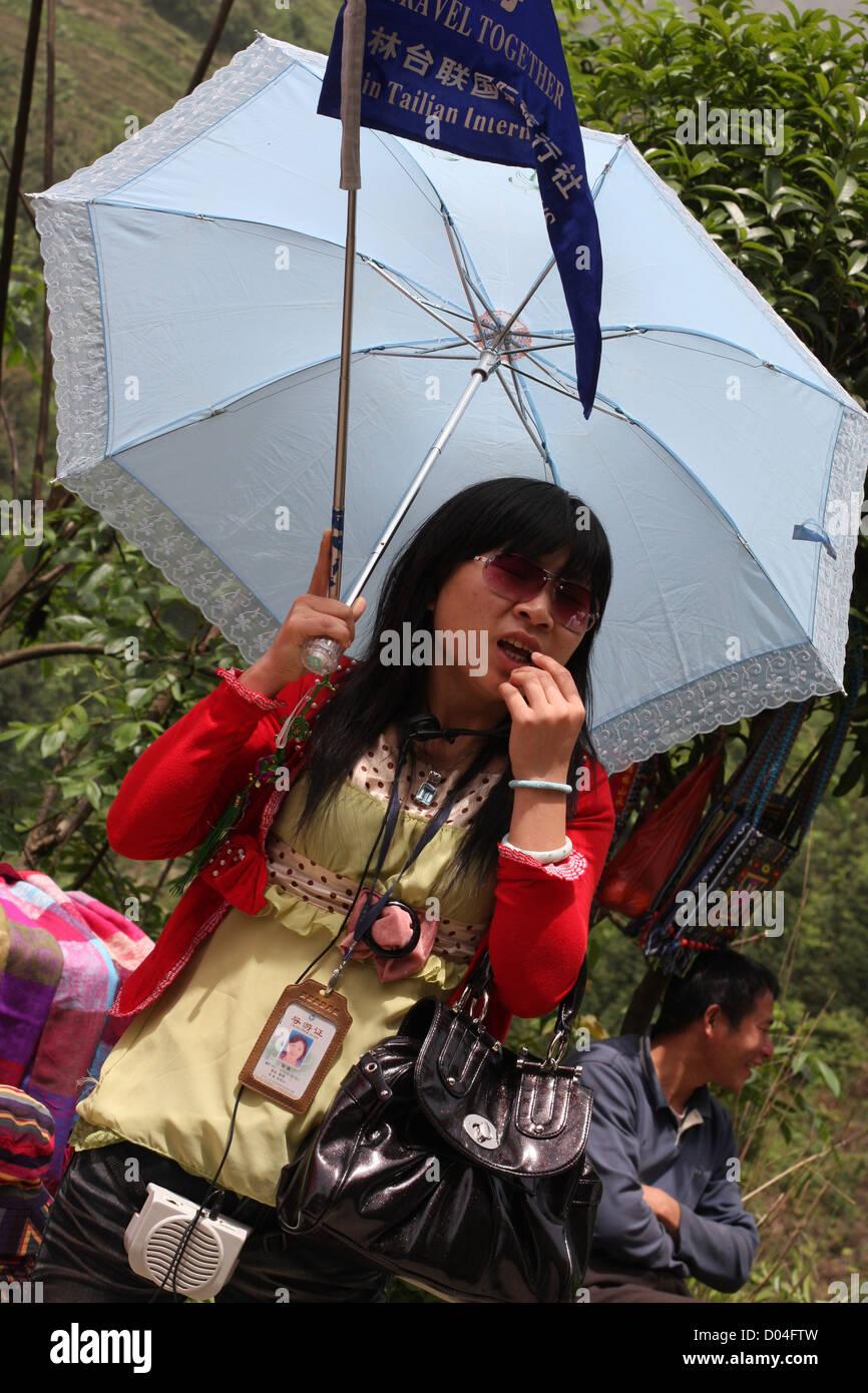 Tour guide to Dragon's Backbone Rice Terraces, Longsheng, Guangxi - Stock Image