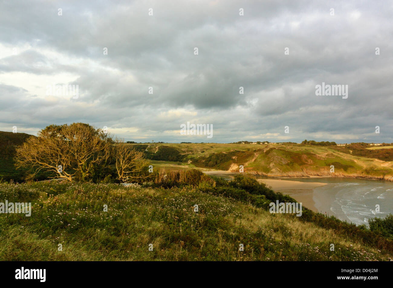 Looking Eastwards over the beach at Three Cliffs Bay in Gower, the view from Penmaen Burrows. - Stock Image