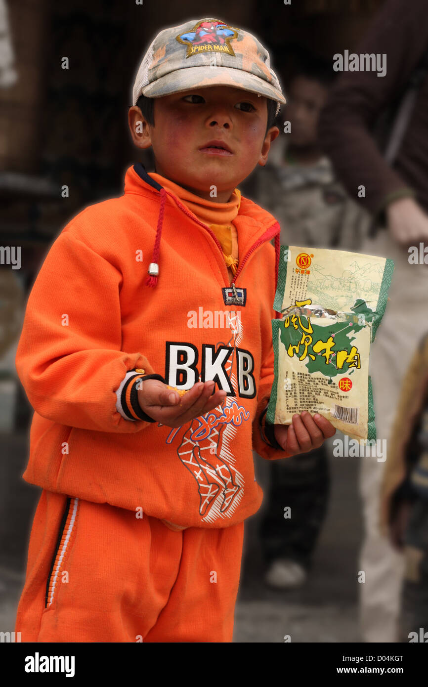 Tibetan boy in a temple, Litang, Sichuan - Stock Image