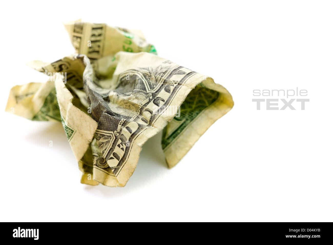 Crumpled Dollar on white. With sample text - Stock Image