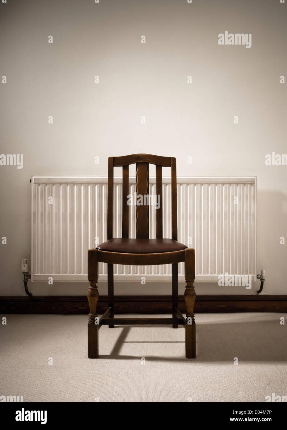 Chair and radiator. - Stock Image