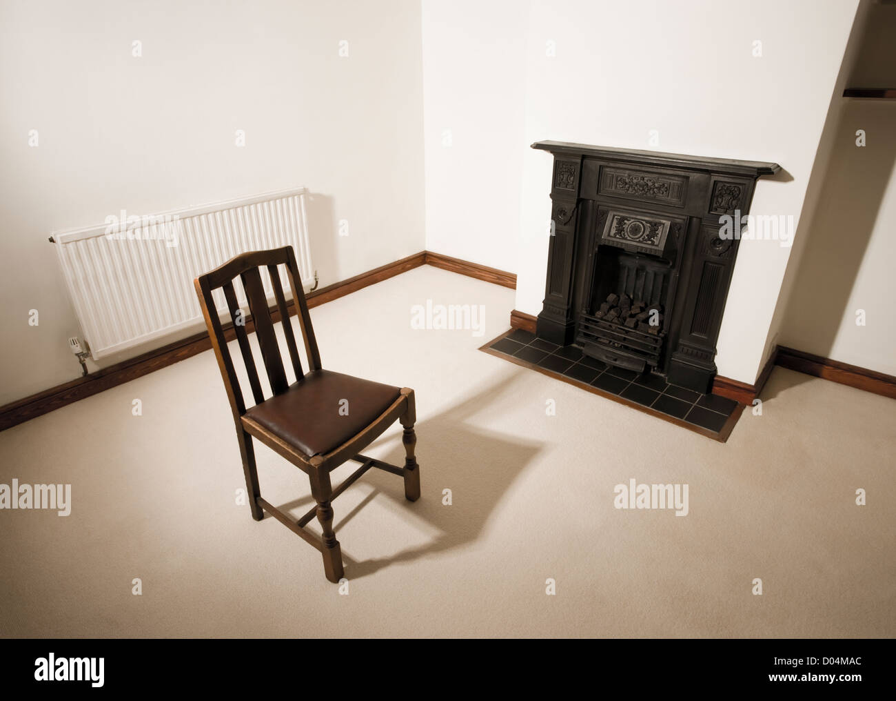 Single chair in empty room. - Stock Image
