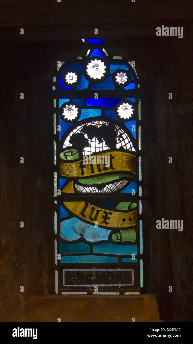 A beautiful, small stained glass window in the upper levels of St Magnus Cathedral, Kikwall, Orkney. - Stock Image