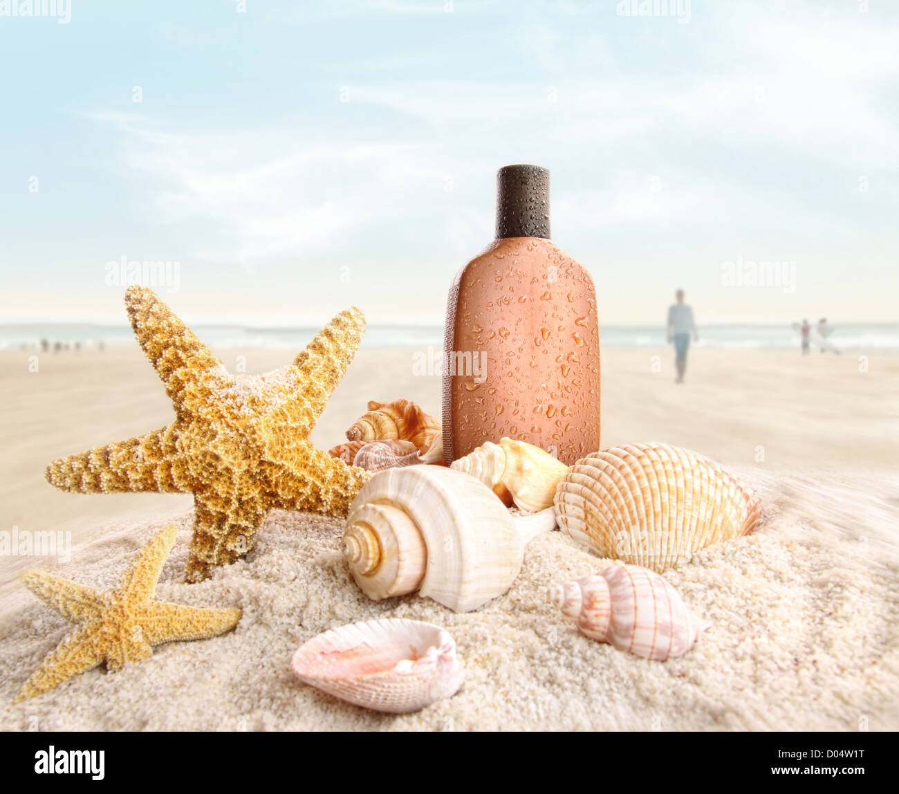 Suntan lotion and seashells with people on the beach - Stock Image