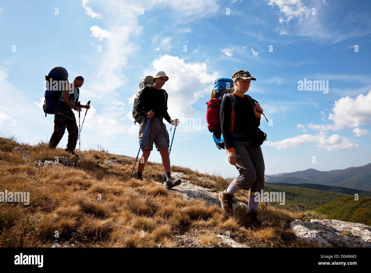 backpacker  in mountains - Stock Image