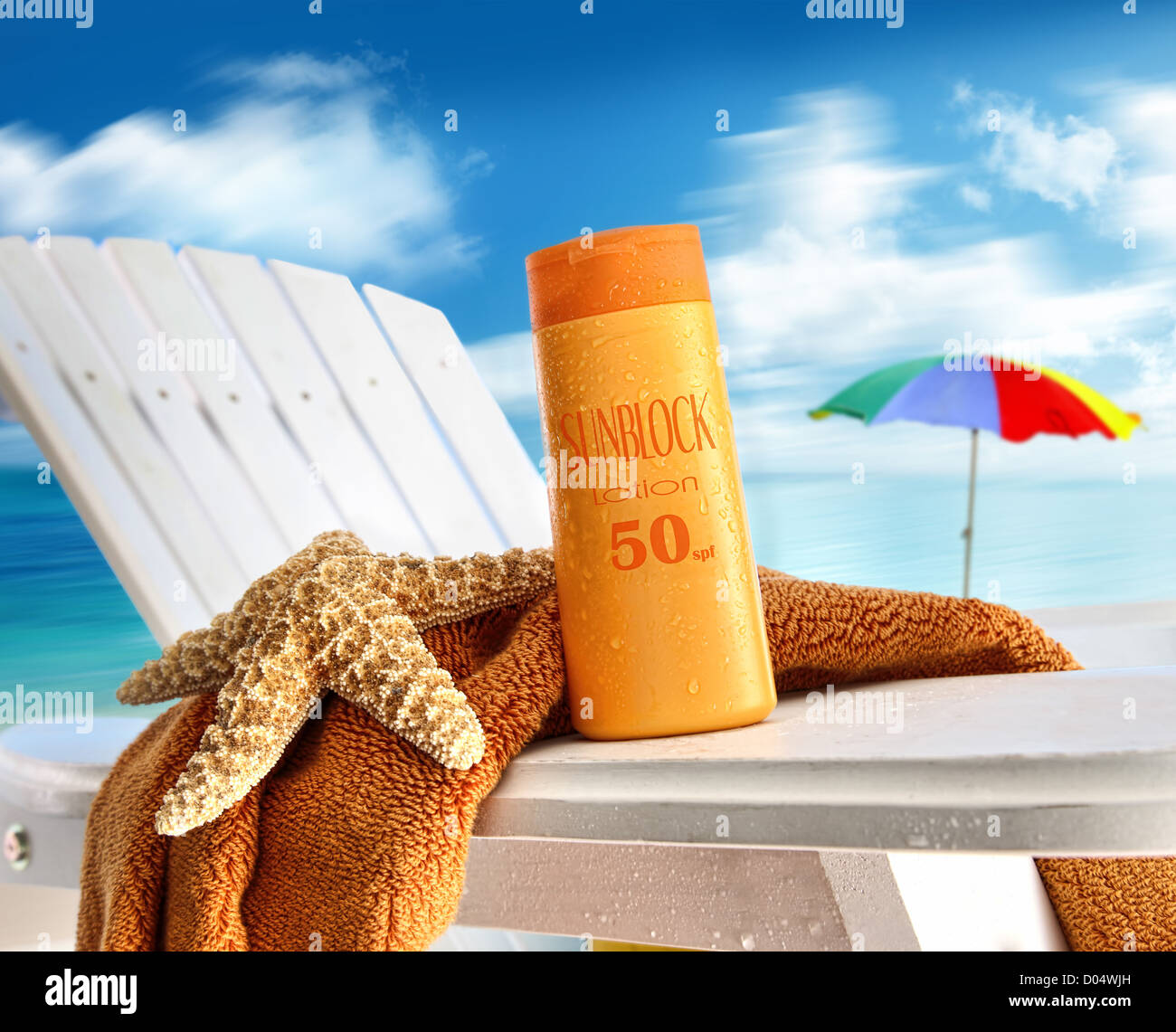 Suntan lotion on chair at the  beach - Stock Image