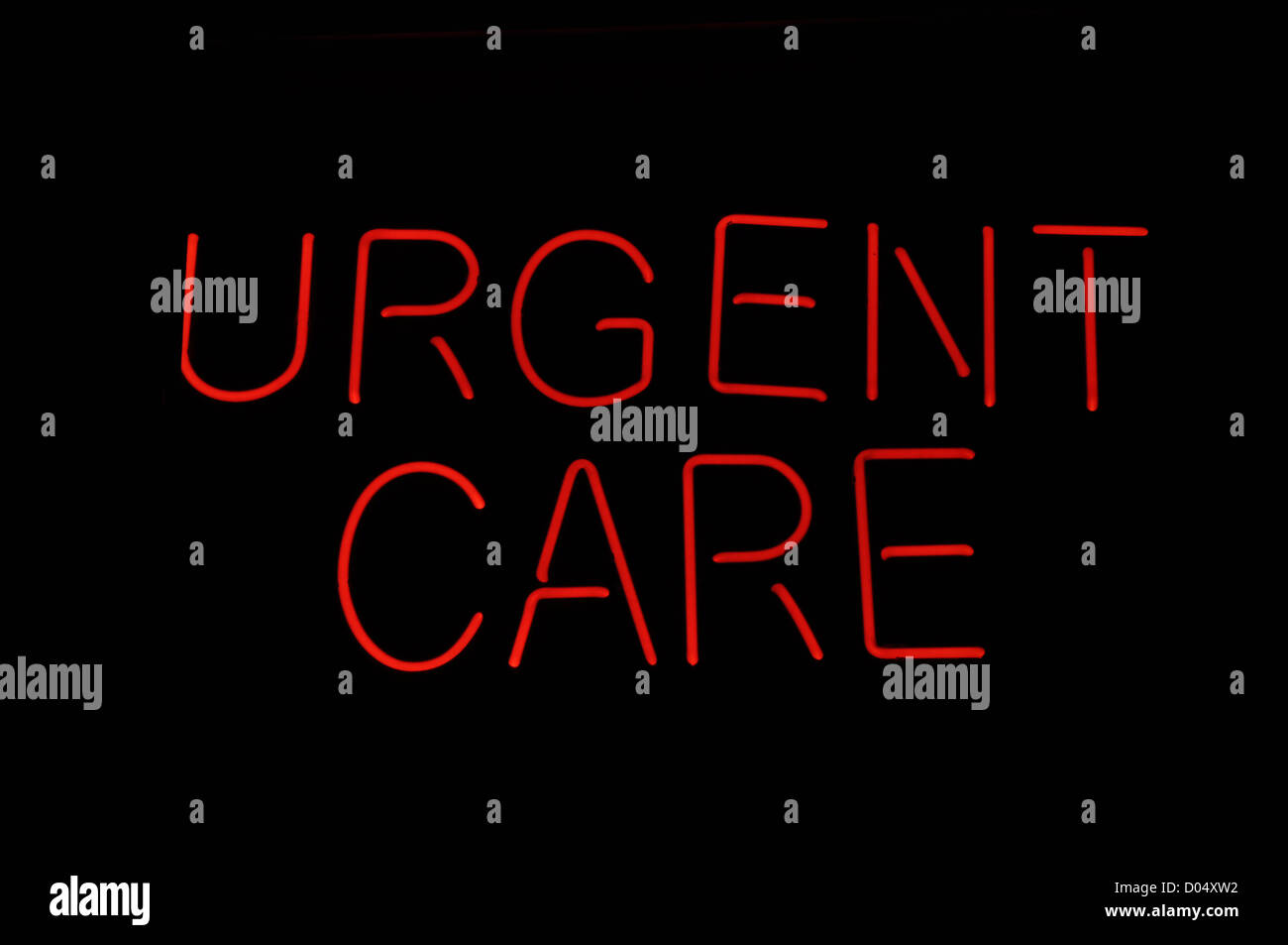 Medical Red Urgent Care Neon Sign against black - Stock Image