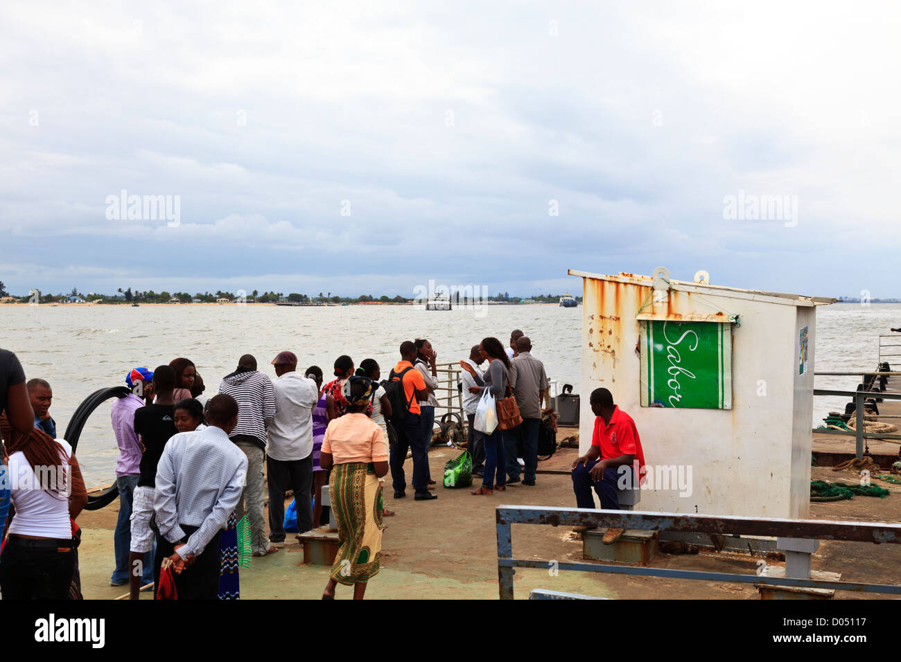 People wait to catch the ferry at Maputo to cross to Catembe in Mozambique Stock Photo