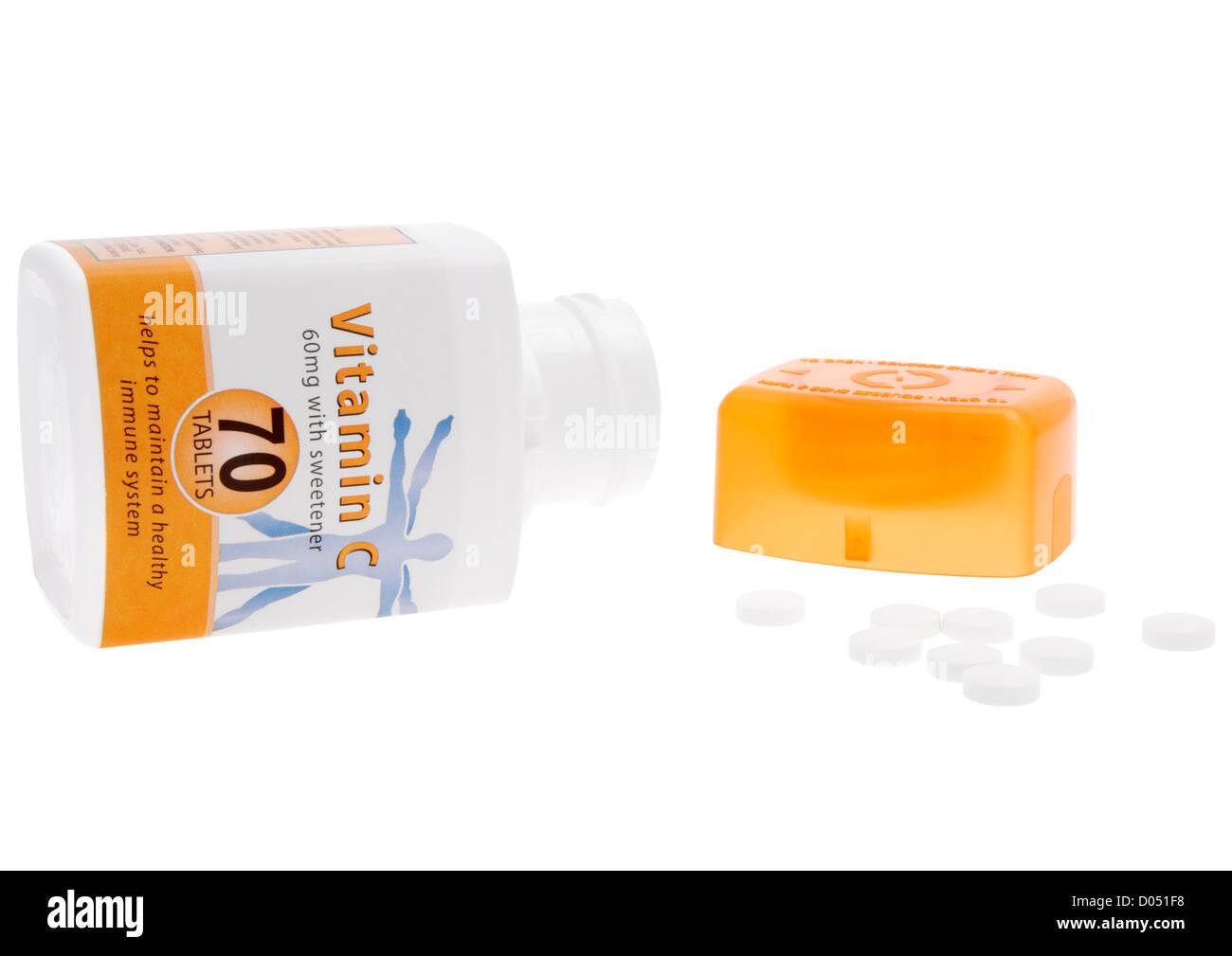 Bottle of vitamin C tablets on white background - Stock Image