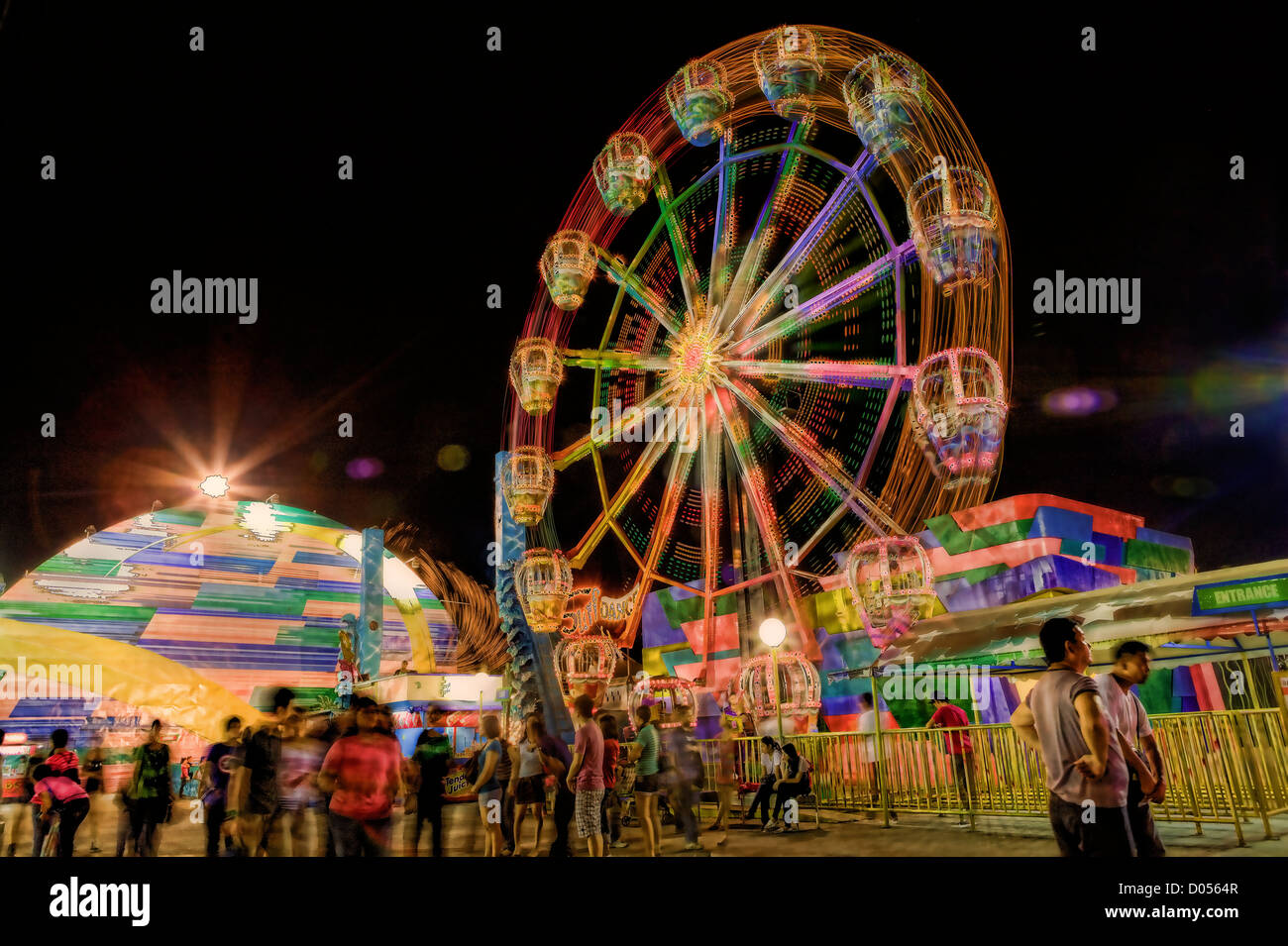 Creative collage of a night scene at Star City, Manila, Philippines using HDR and motion blur. - Stock Image