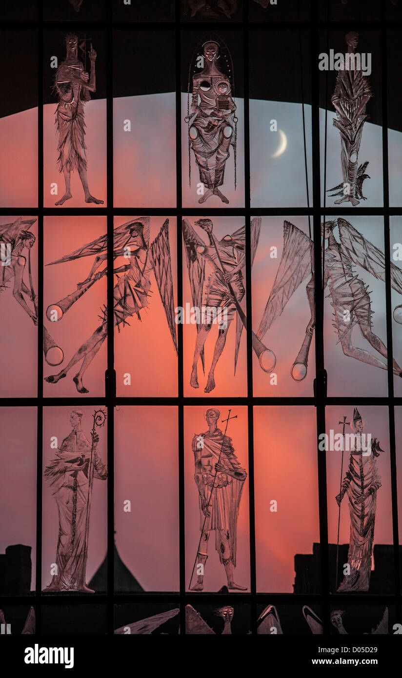 Evening sunset with a new crescent moon seen through the West Screen at Coventry Cathedral, West Midlands, UK. - Stock Image