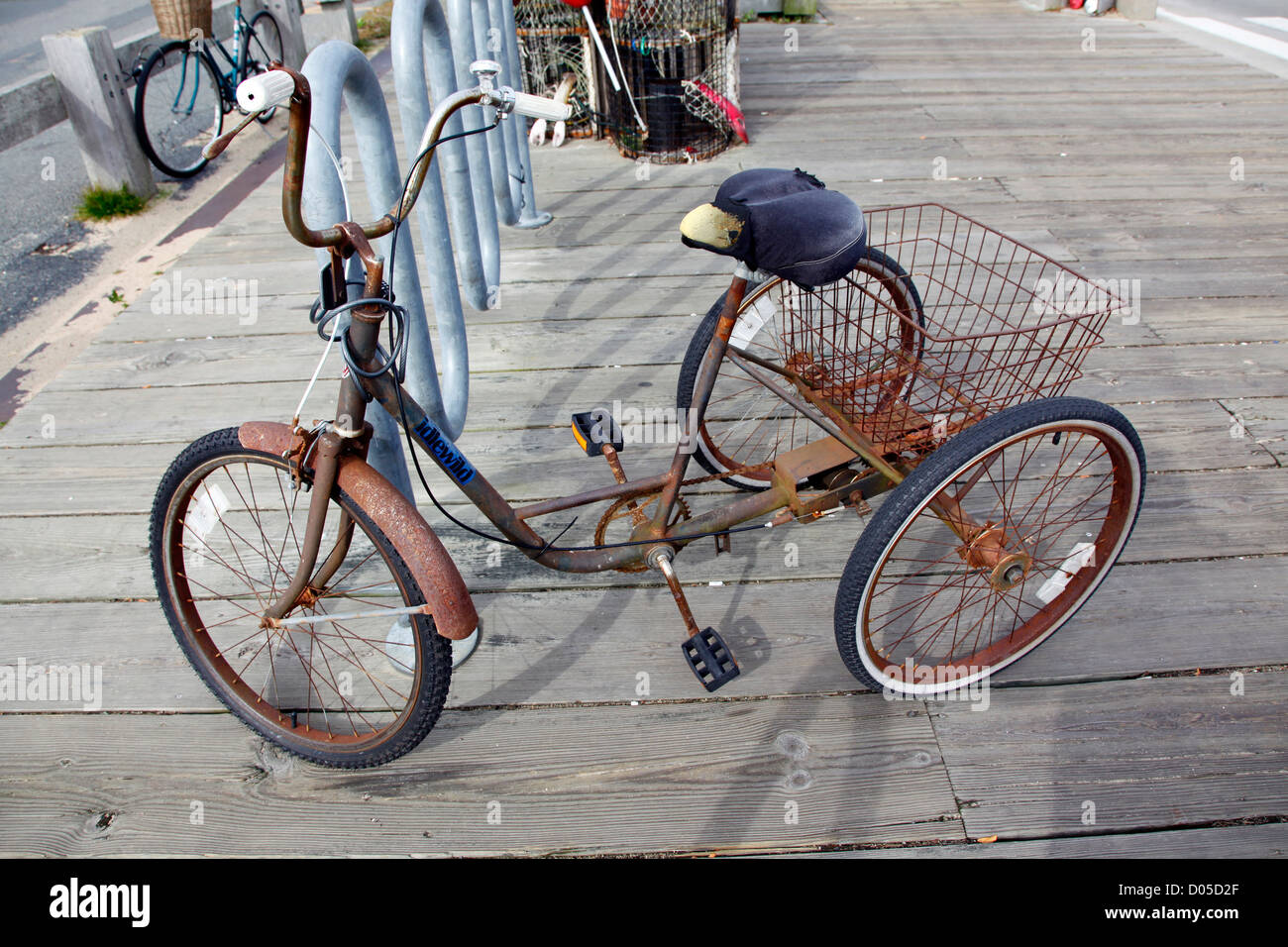 Rusty tricycle bicycle, Provincetown, Cape Cod, Massachusetts, America - Stock Image